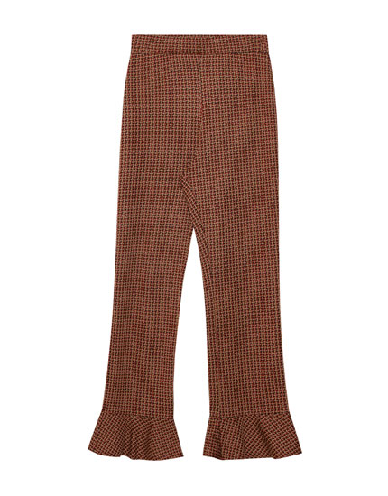 Tailored trousers with ruffled hems
