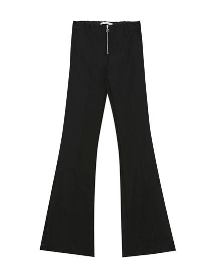 Flared trousers with zip