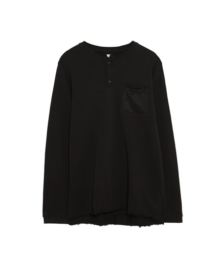 Sweatshirt with pocket and button collar