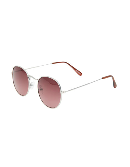 Sunglasses with maroon lenses