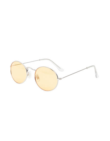Oval sunglasses with coloured lenses