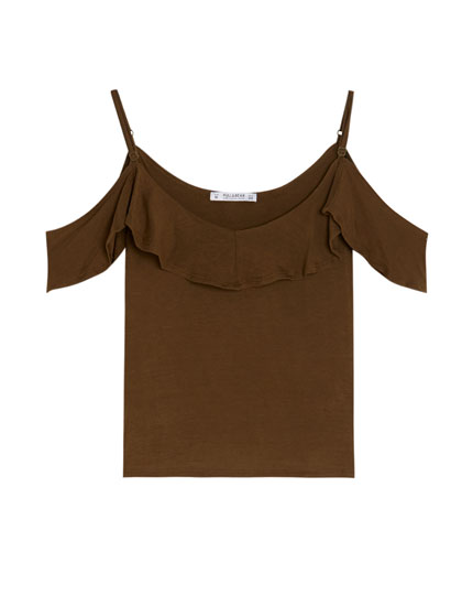 Top with thin straps and a ruffle