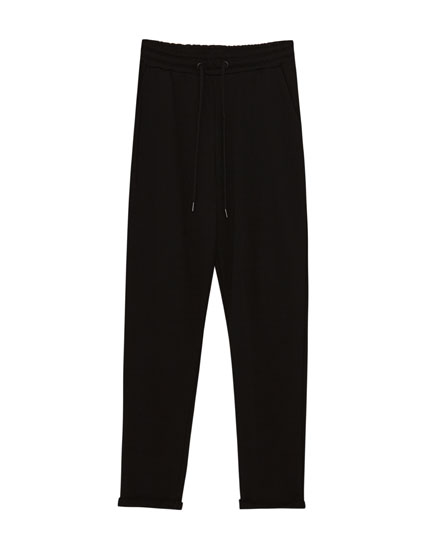 Jogging trousers with turn-up cuffs