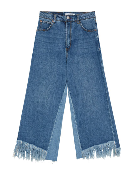 Kick flare jeans with frayed hem