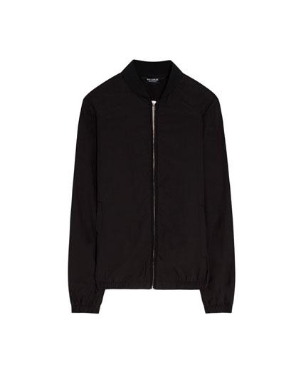 Bomber jacket with skull print