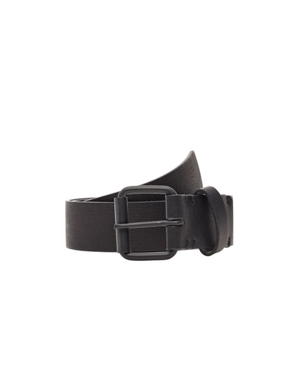 Belt with metal buckle and embossed detail.