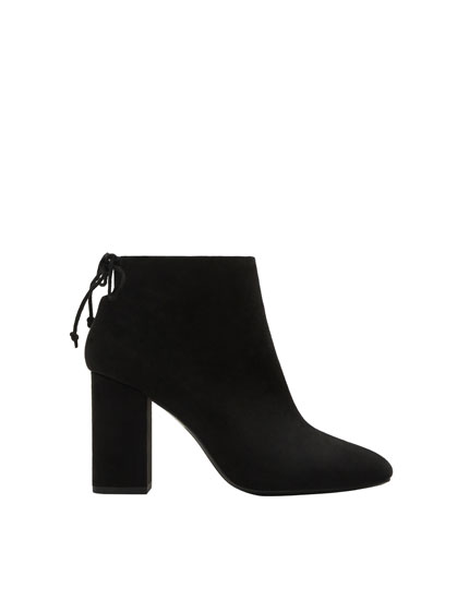 High heel ankle boots with tied detail