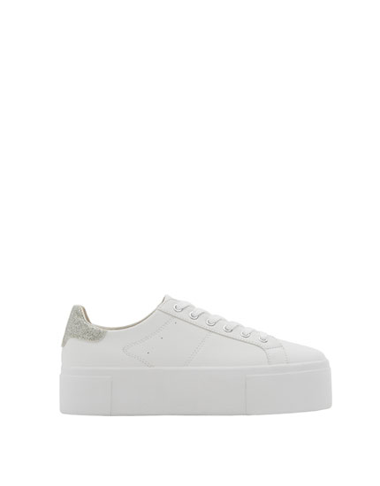 Sneakers with embellished detail.