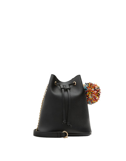 Mini black bucket bag with pompom detail