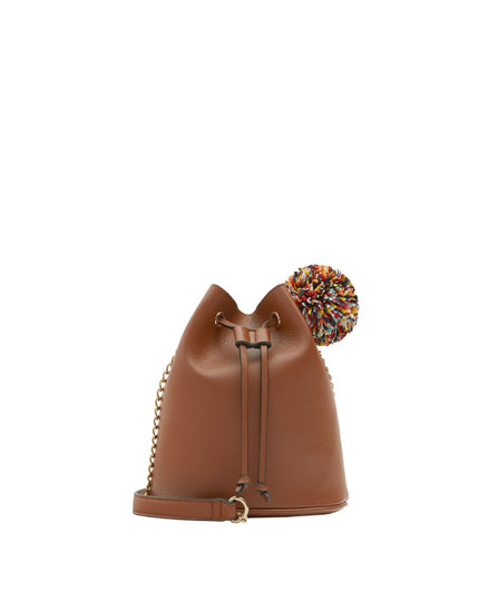 Mini brown bucket bag with pompom detail