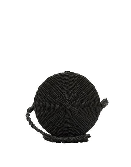 Round black crossbody bag