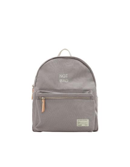 Grey fabric mini backpack with slogan