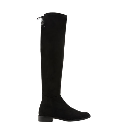 Flat boots with lace-up detail.