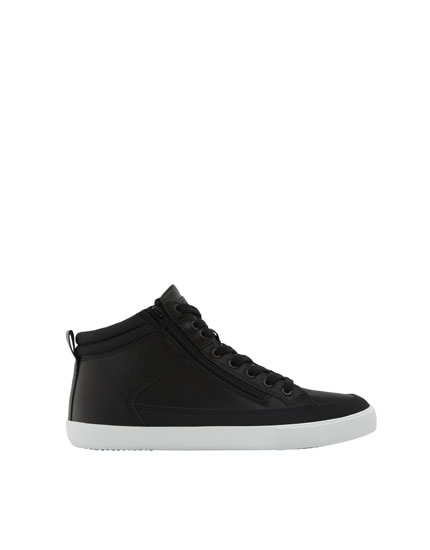 Black high-top sneakers with zip