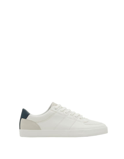 White sneakers with die-cut detail