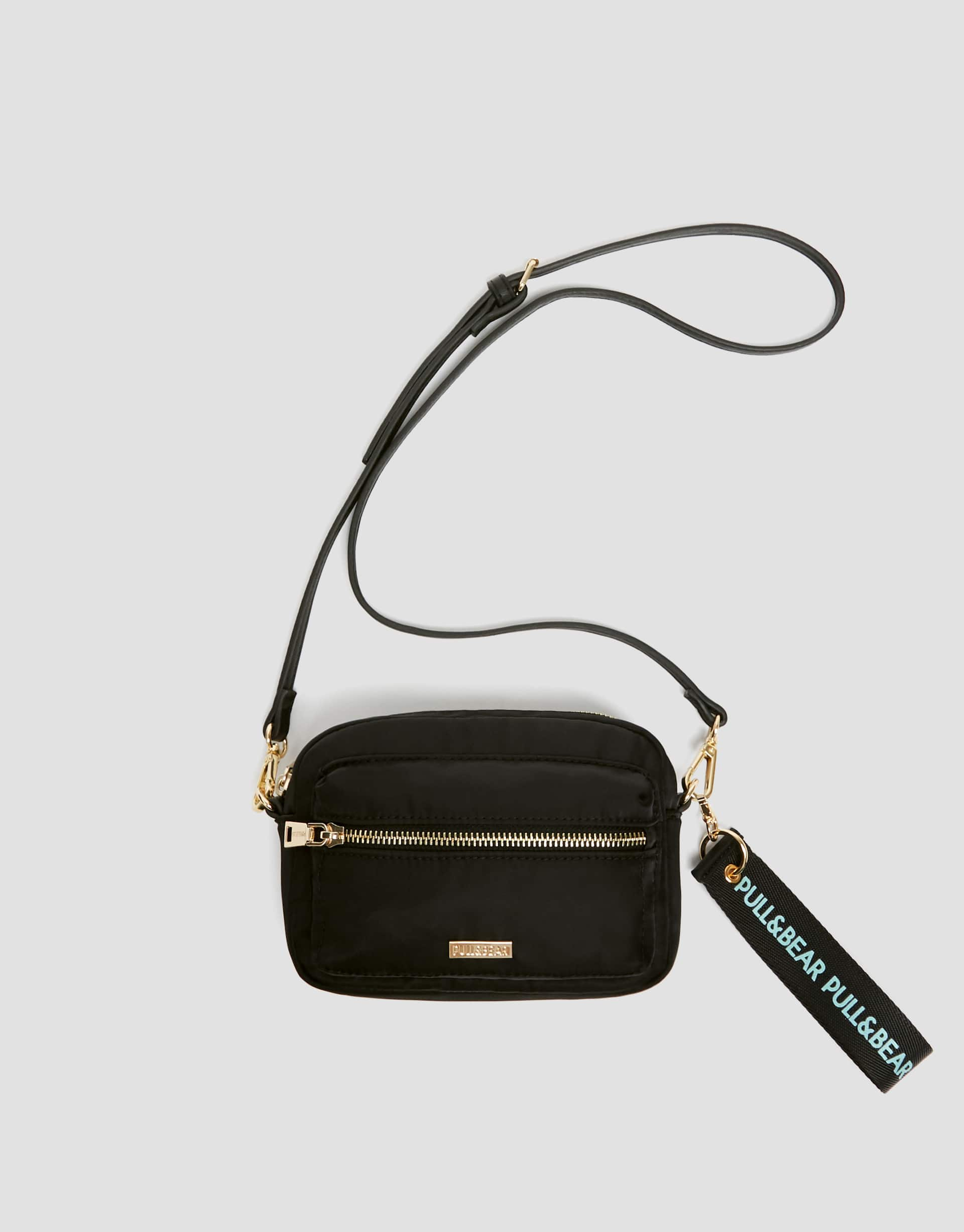 Stretchy black mini crossbody bag