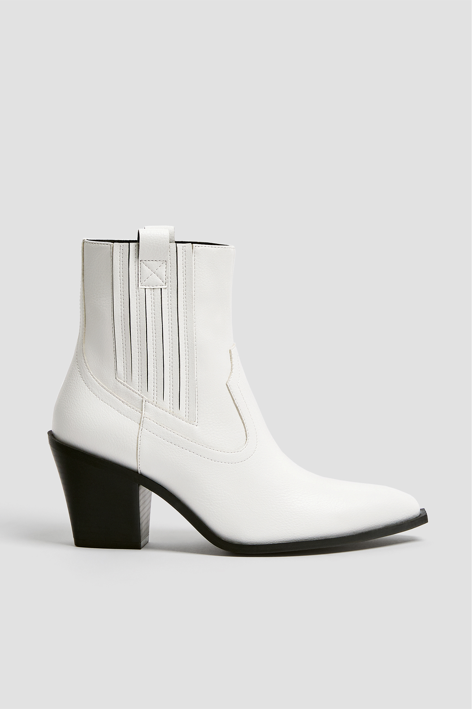 White cowboy ankle boots with glossy