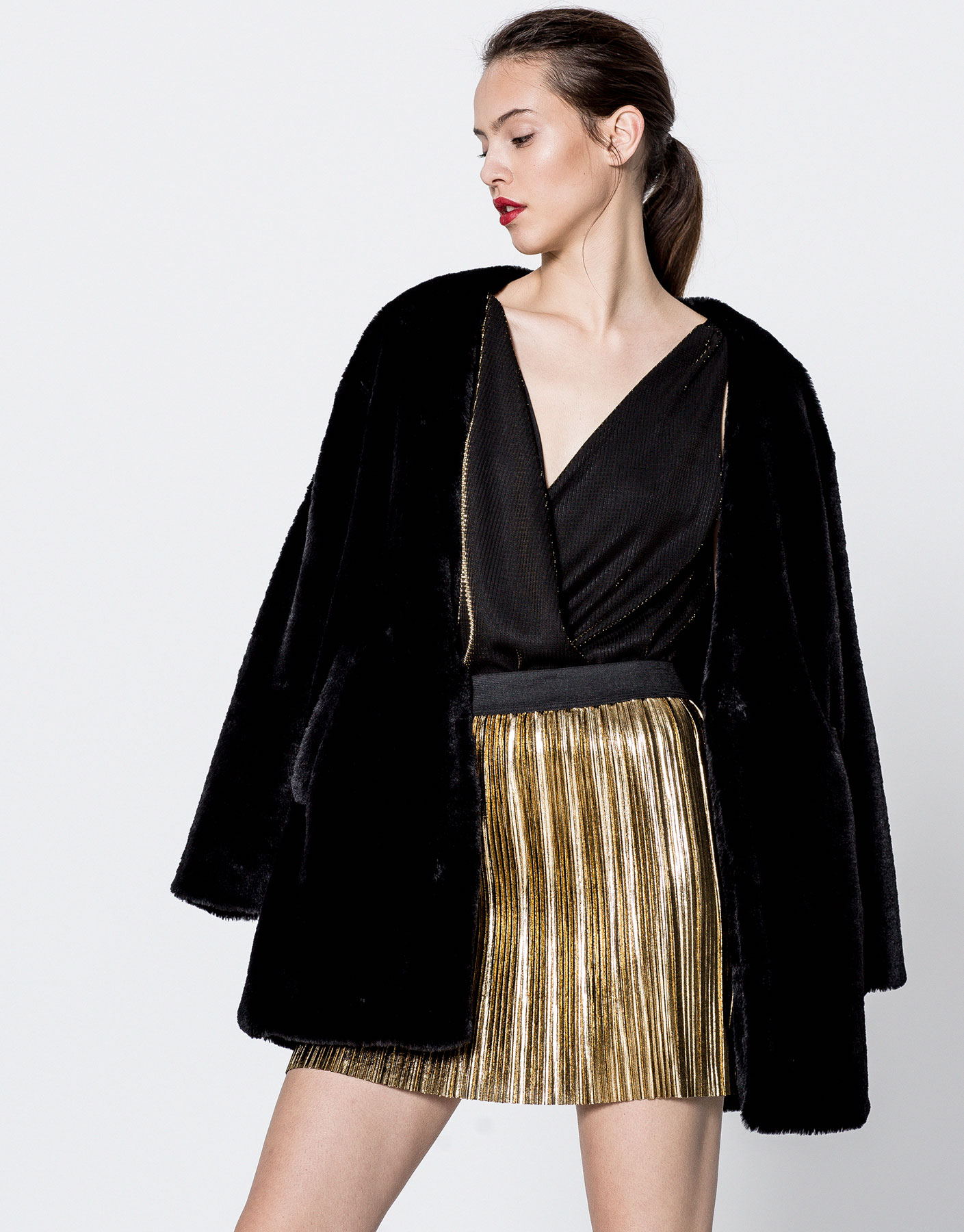 Pleated metallic mini skirt