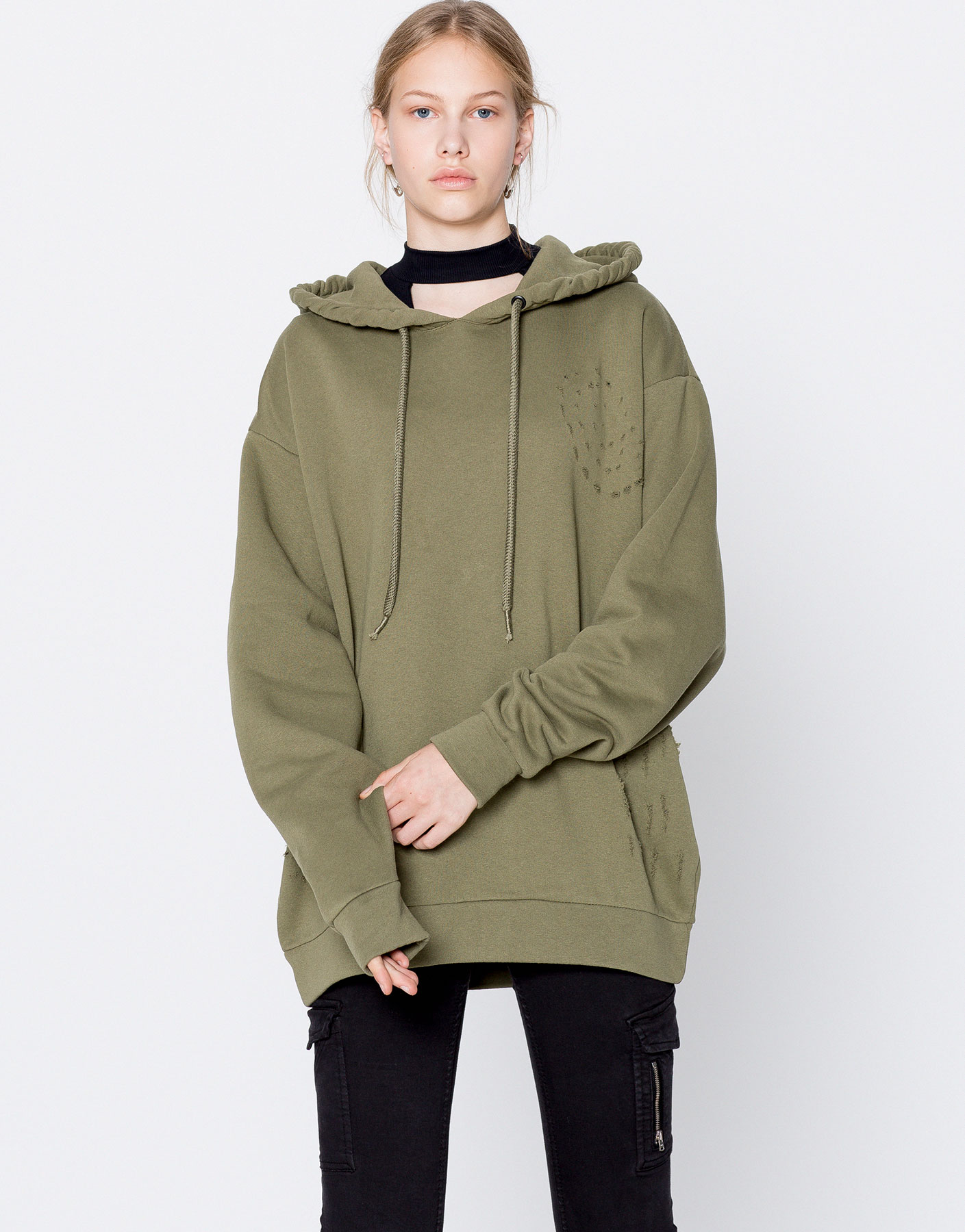 Ripped hooded text sweatshirt