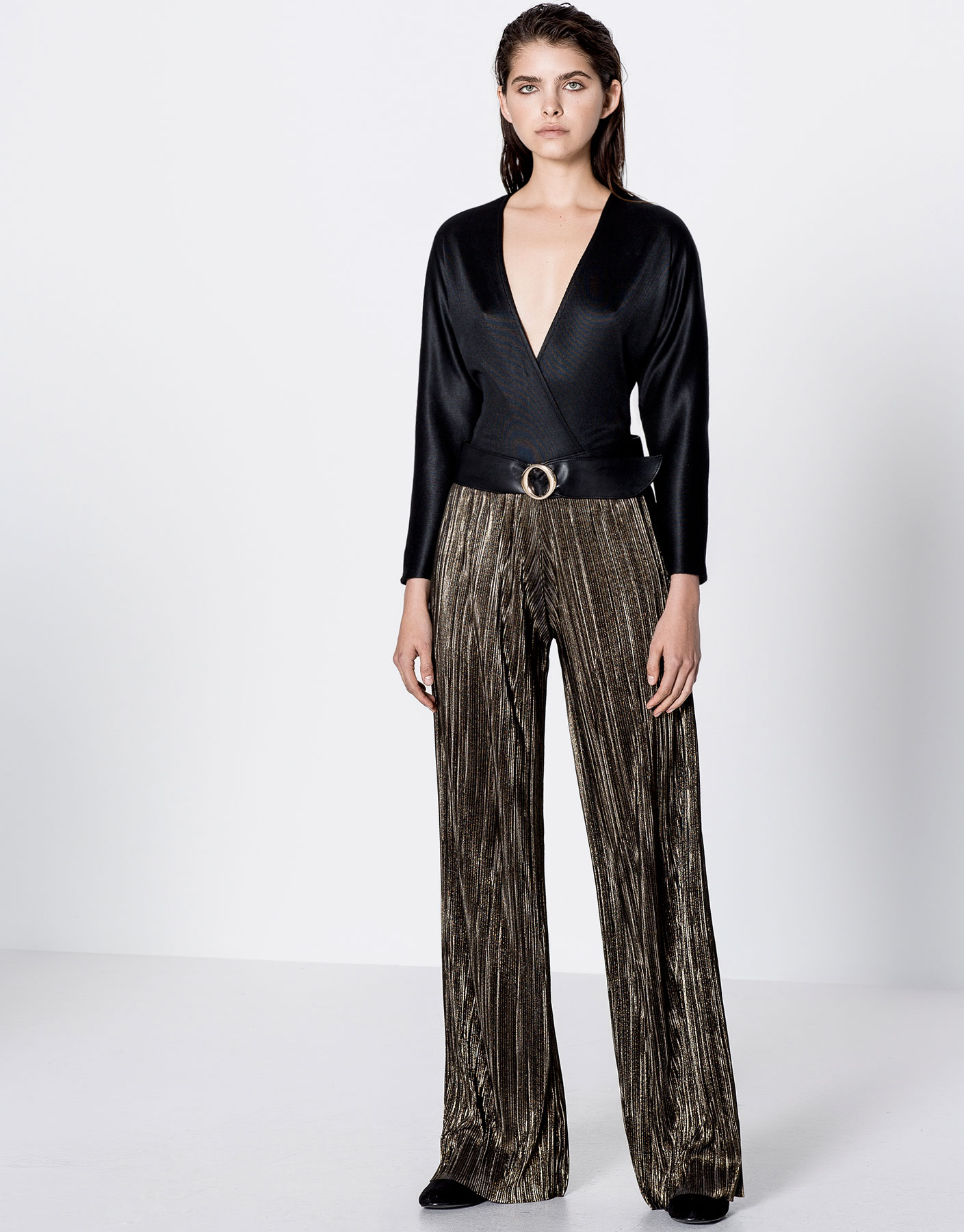 Pleated shiny gold trousers