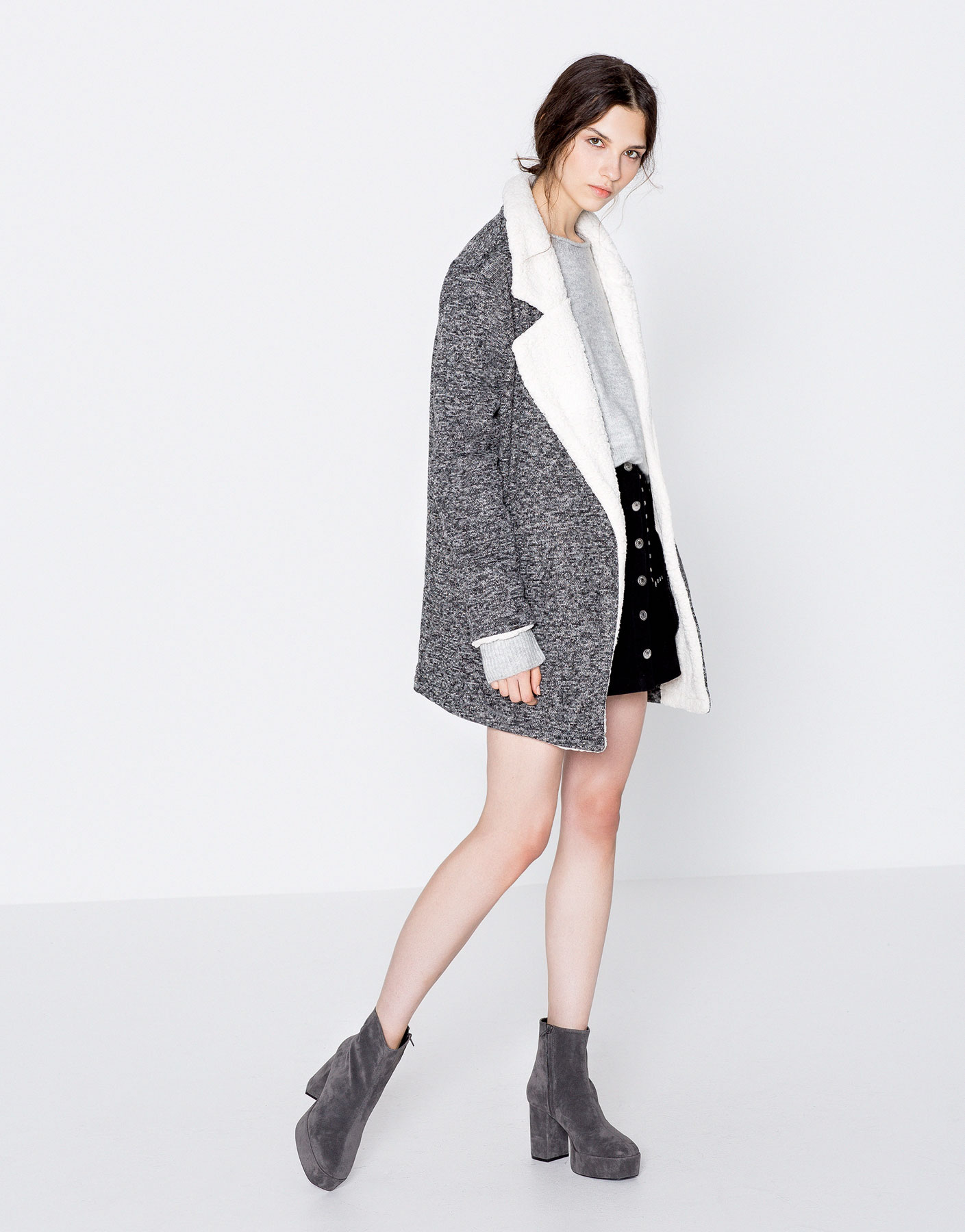 Knit coat with faux-fur lapels