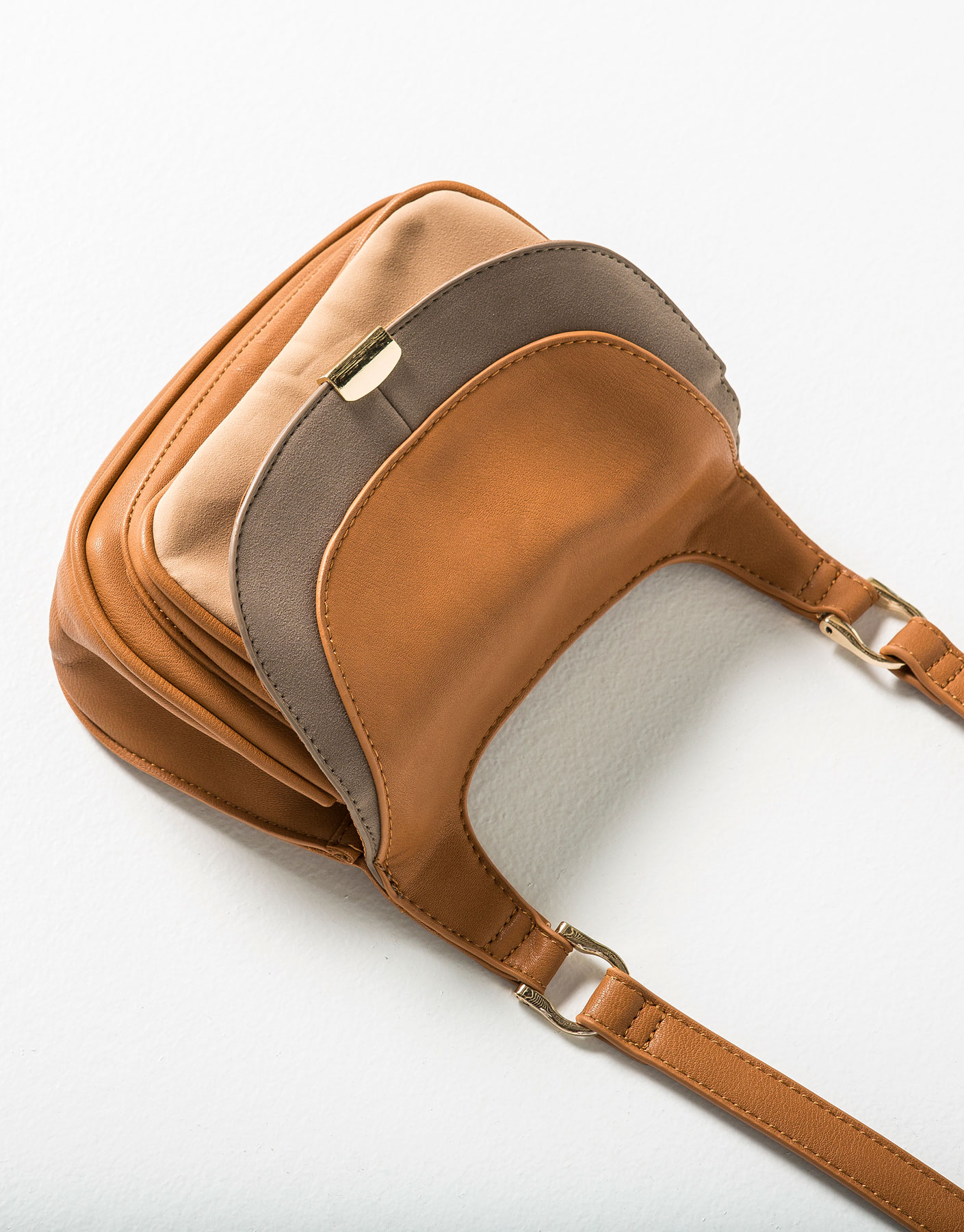 Cross-body bag with flap and piping