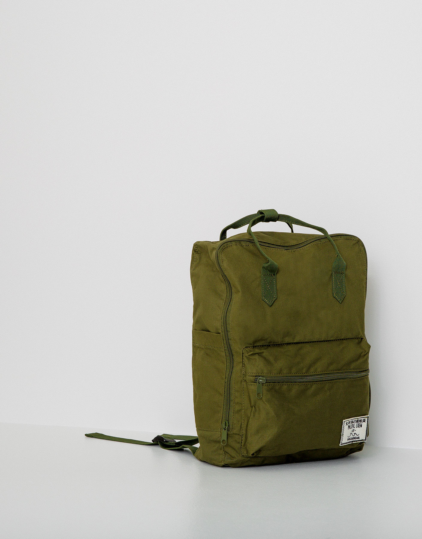 Backpack with handles and pocket