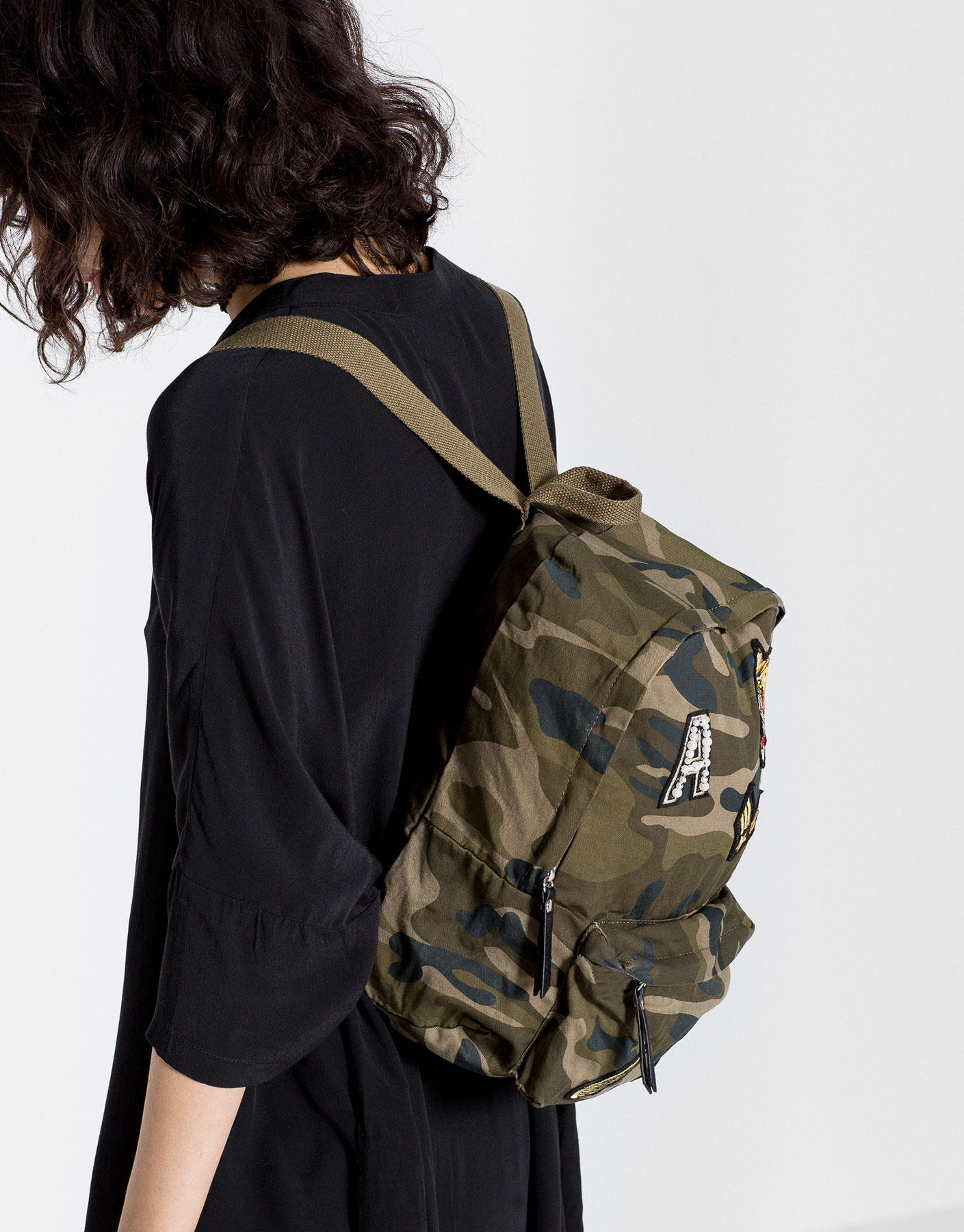 Camouflage backpack with patches