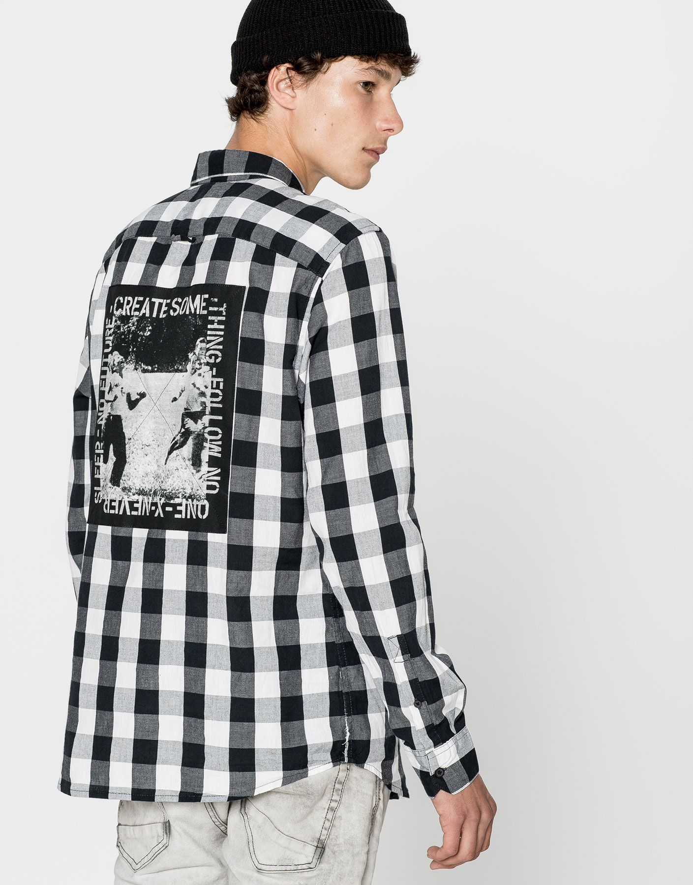 Checkered shirt with patch on back