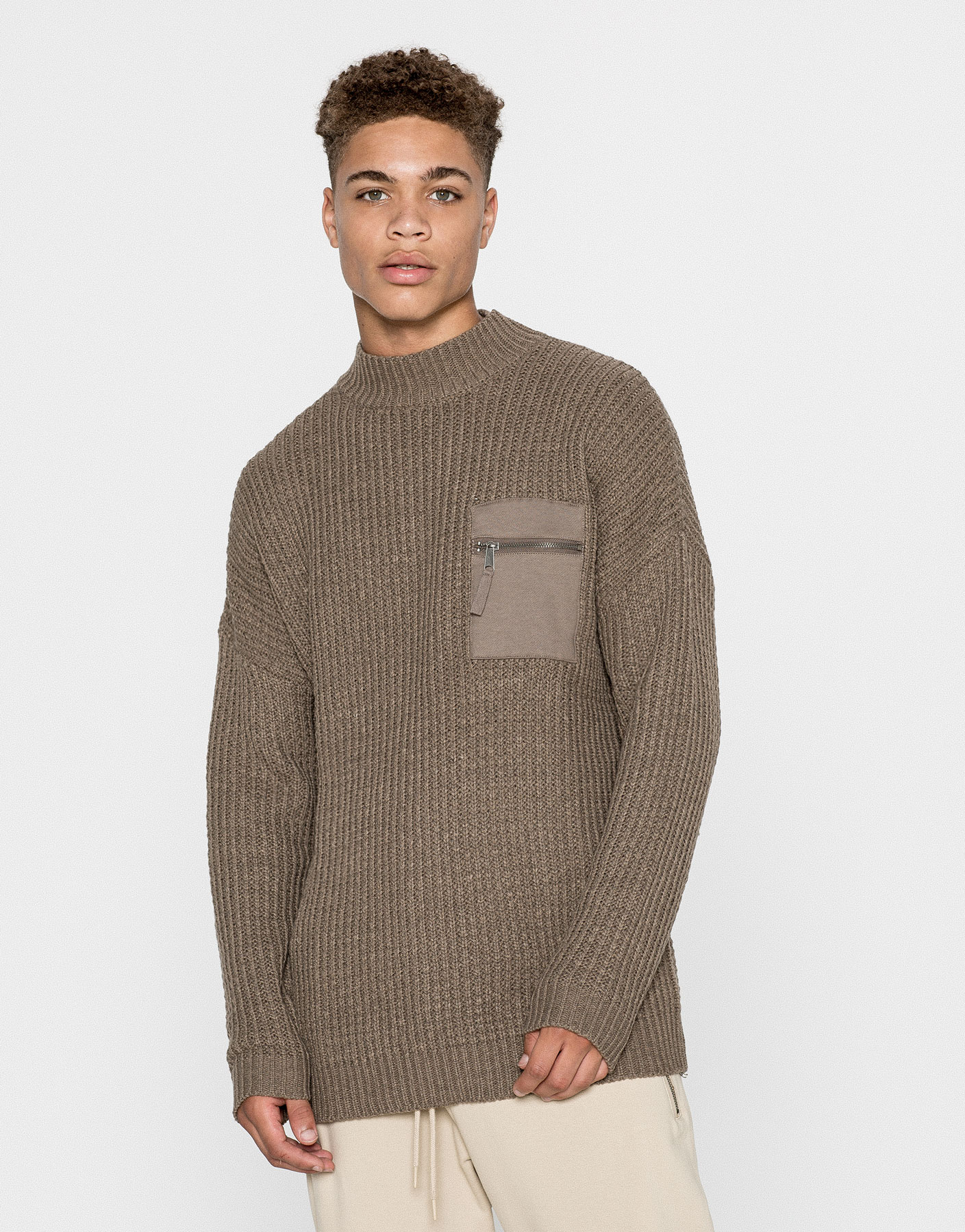 High neck sweater with pocket
