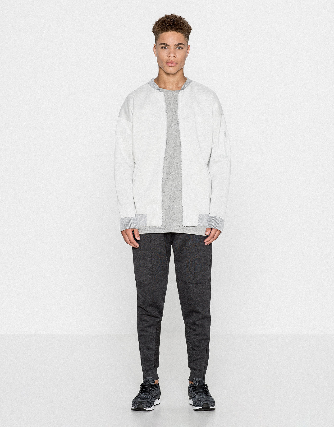 Rubberised technical bomber jacket