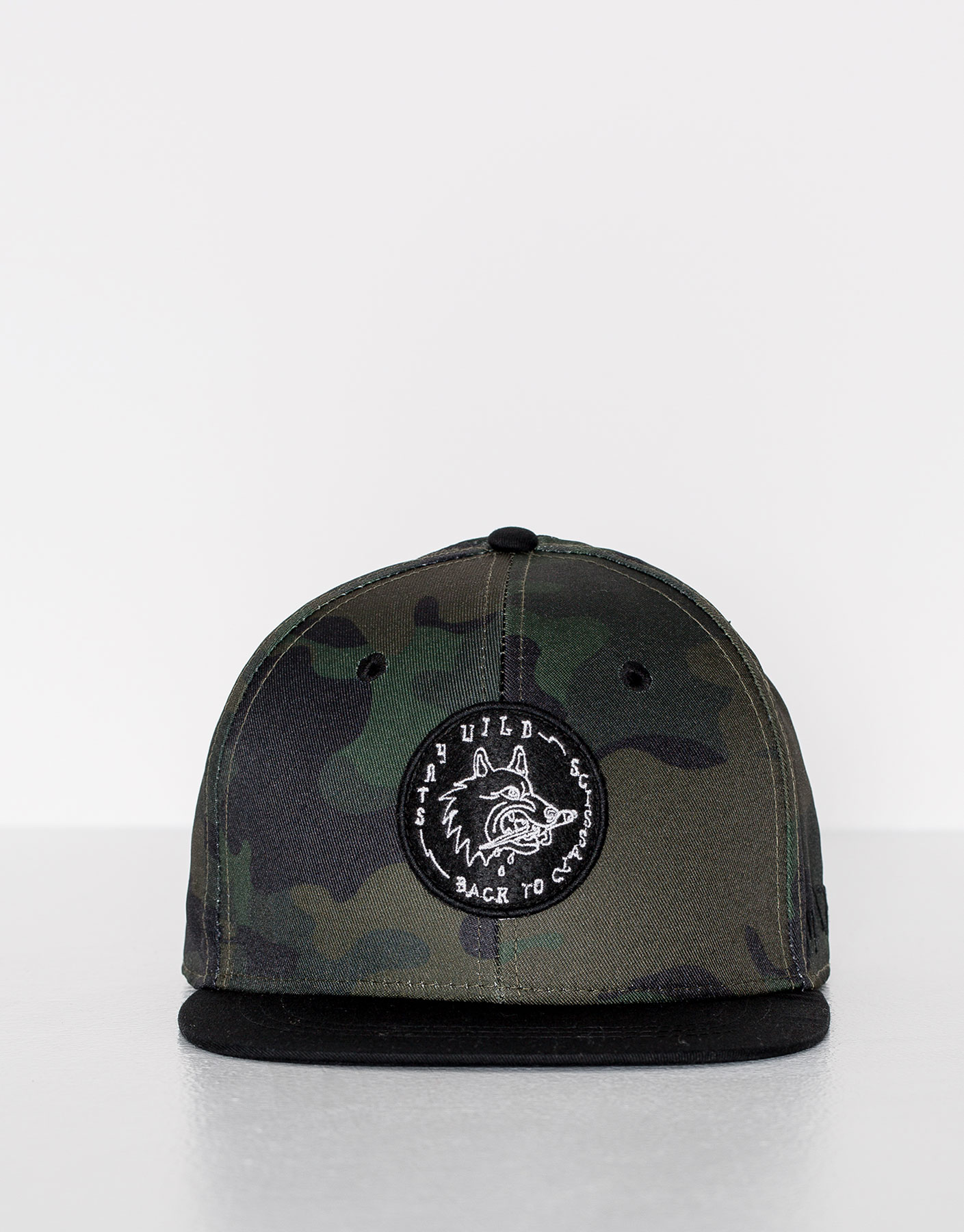 Camouflage cap with a patch