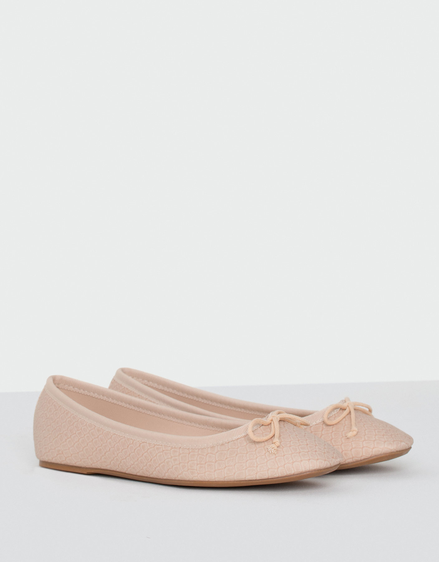 Embossed ballet pumps