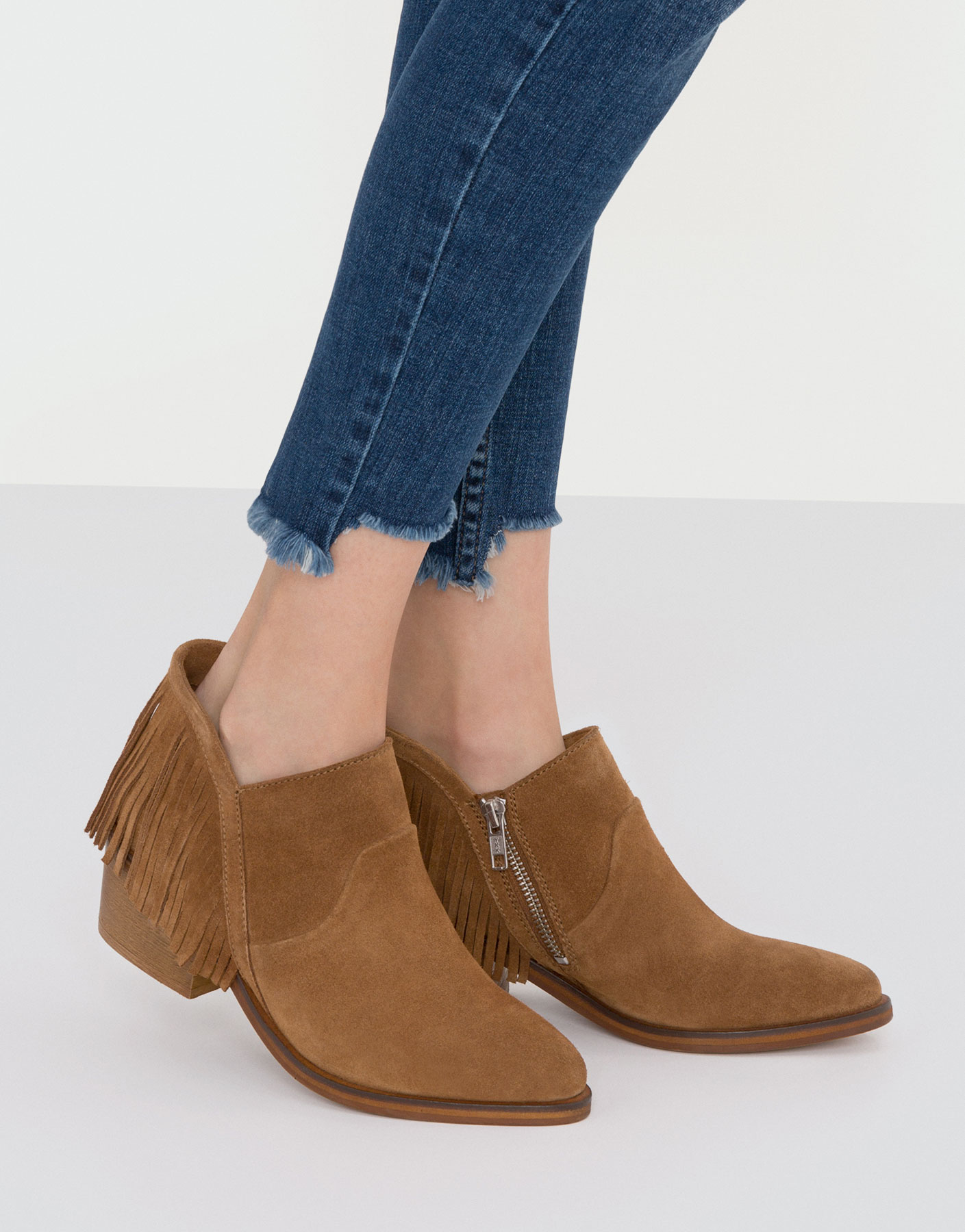 Suede ankle boots with fringing detail