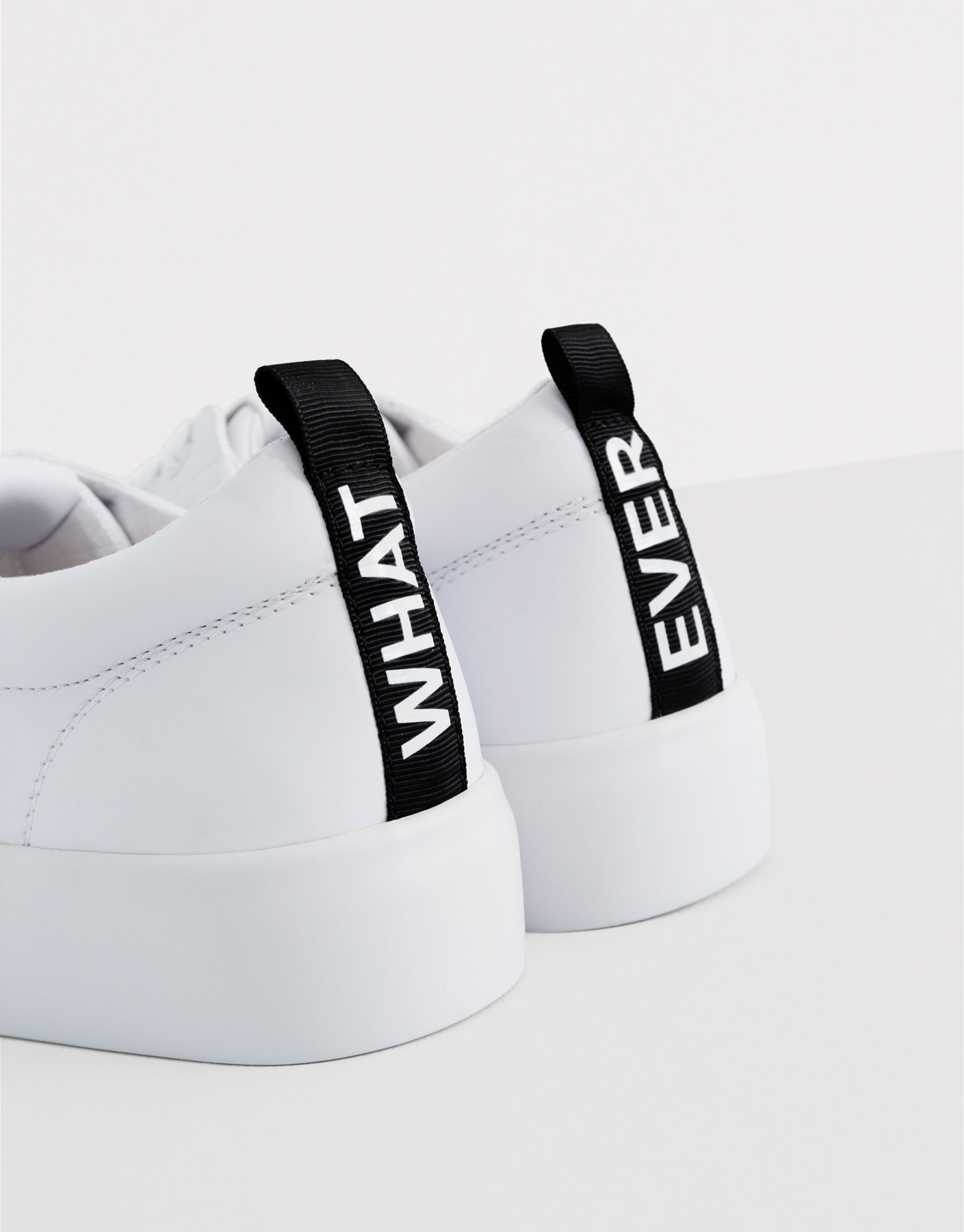 White block plimsolls with message