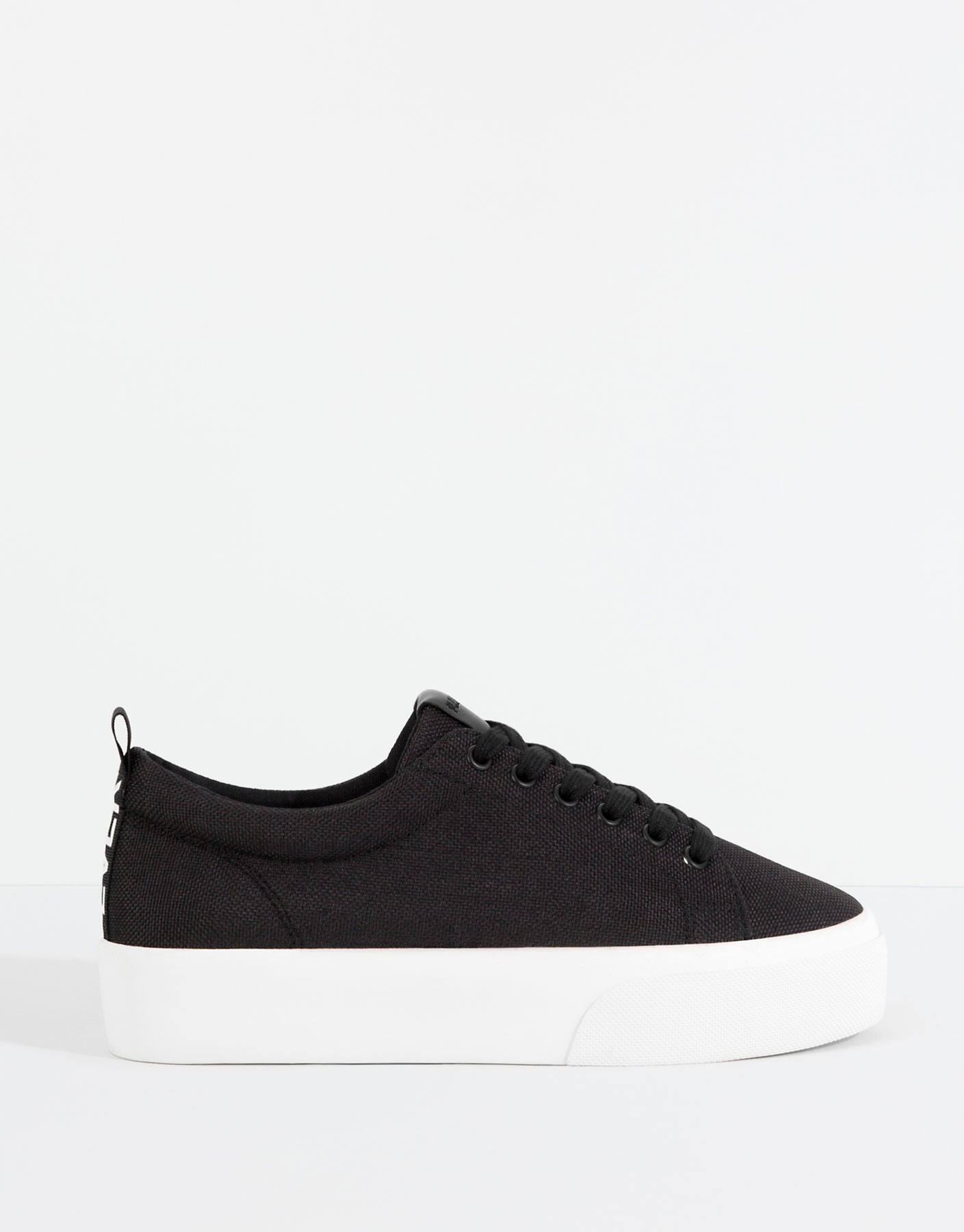 Black block plimsolls with message