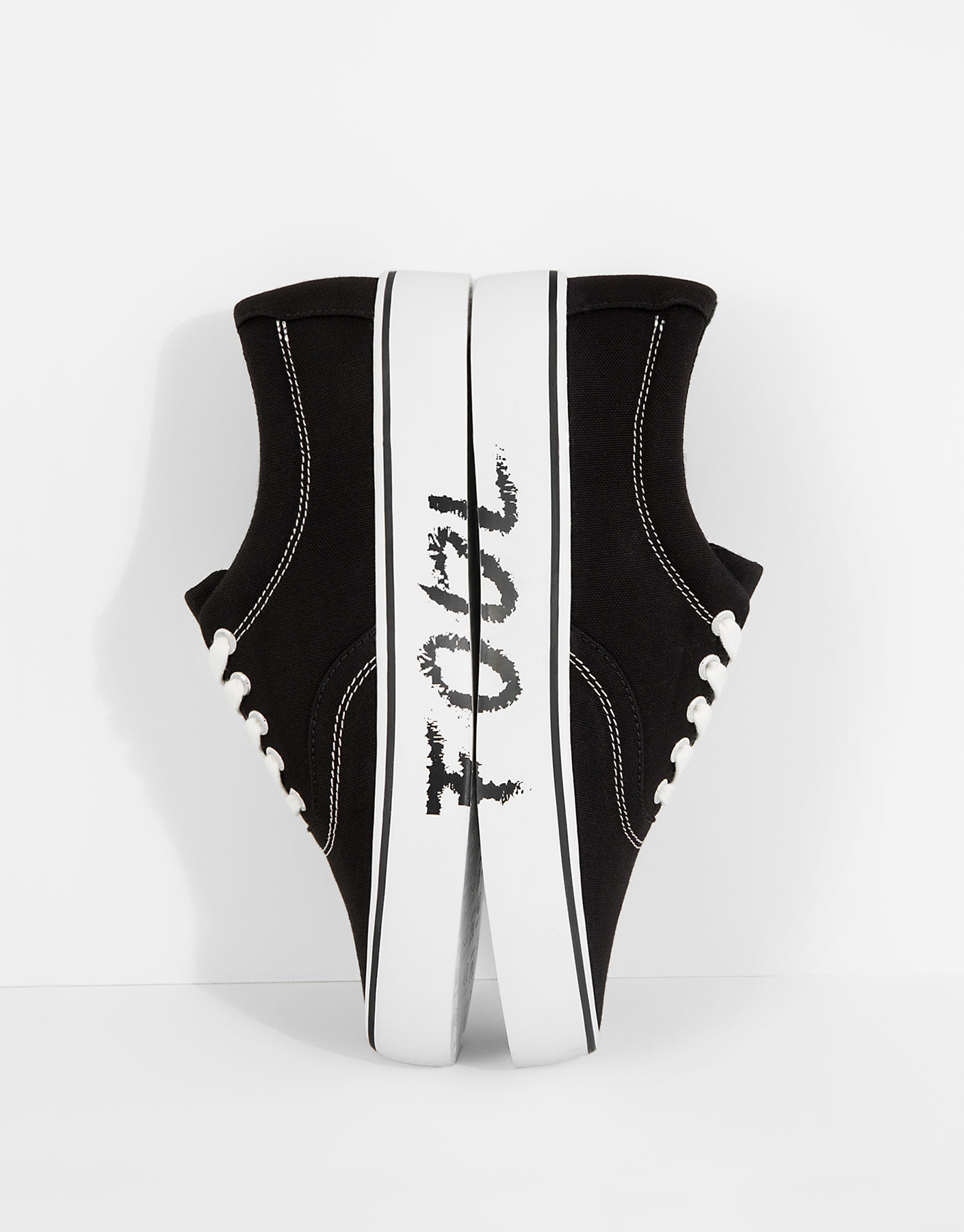 Black message print plimsolls