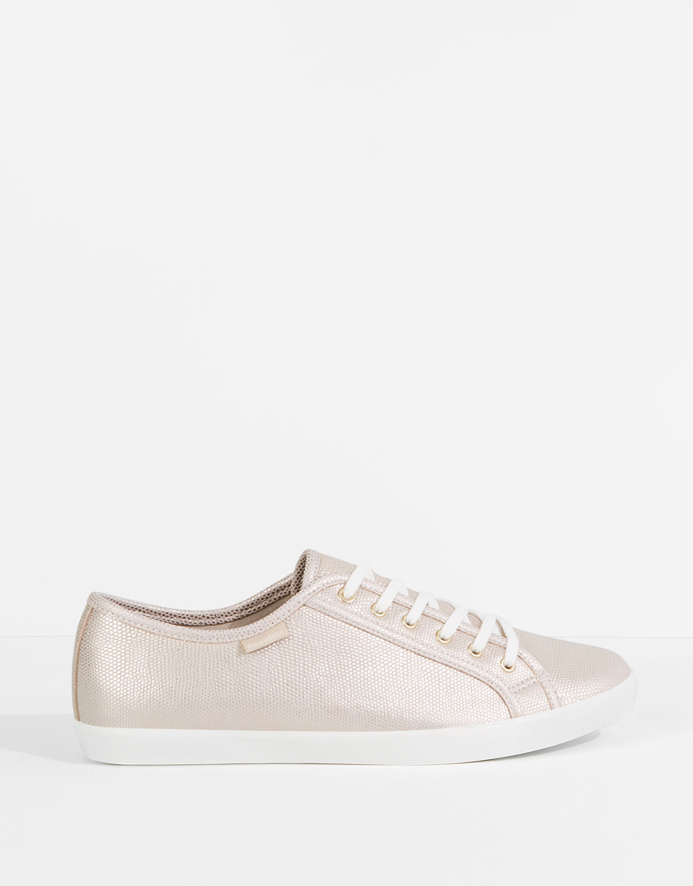 Golden-toned plimsolls