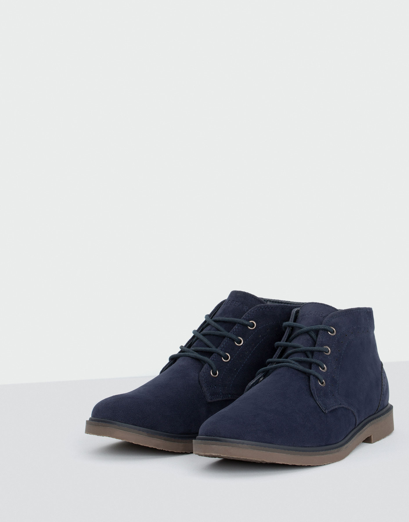 Desert ankle boots with broguing