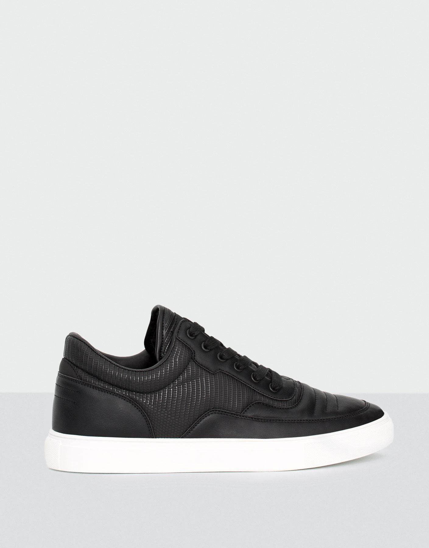 Black sneaker boots