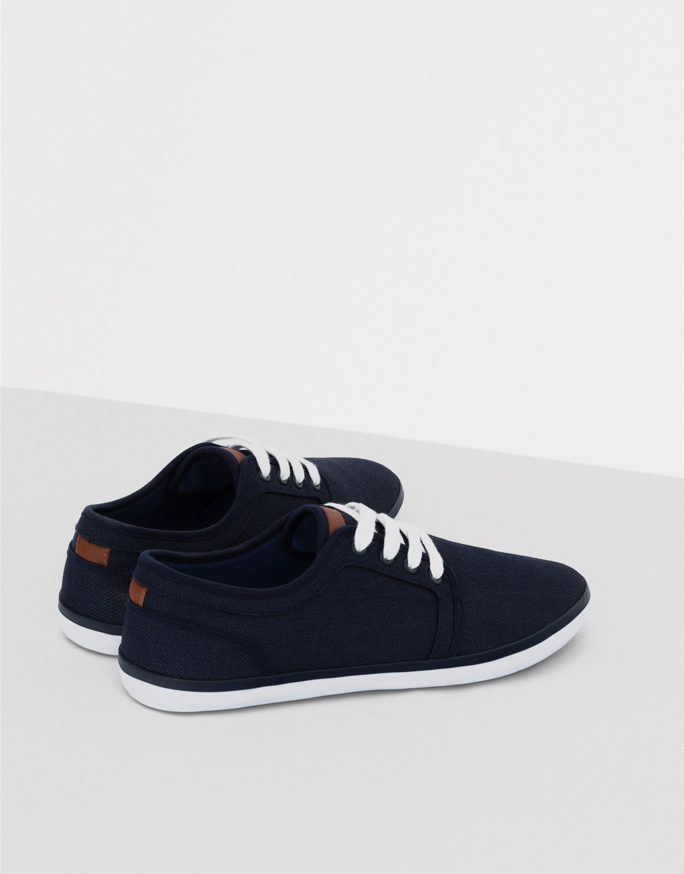 Blue fabric plimsolls