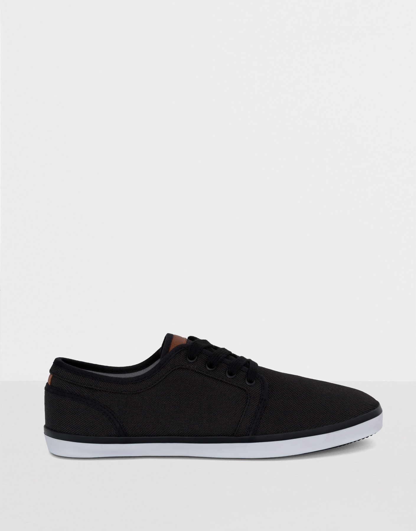 Black fabric plimsolls