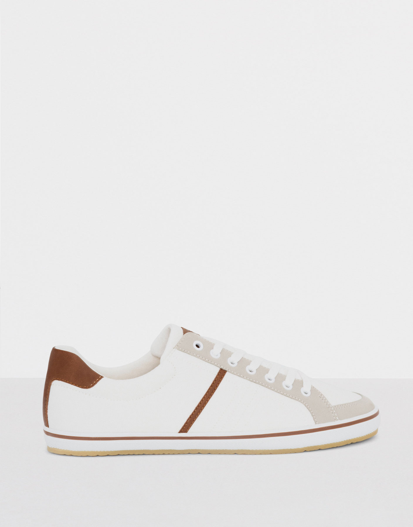 Combined white canvas plimsolls