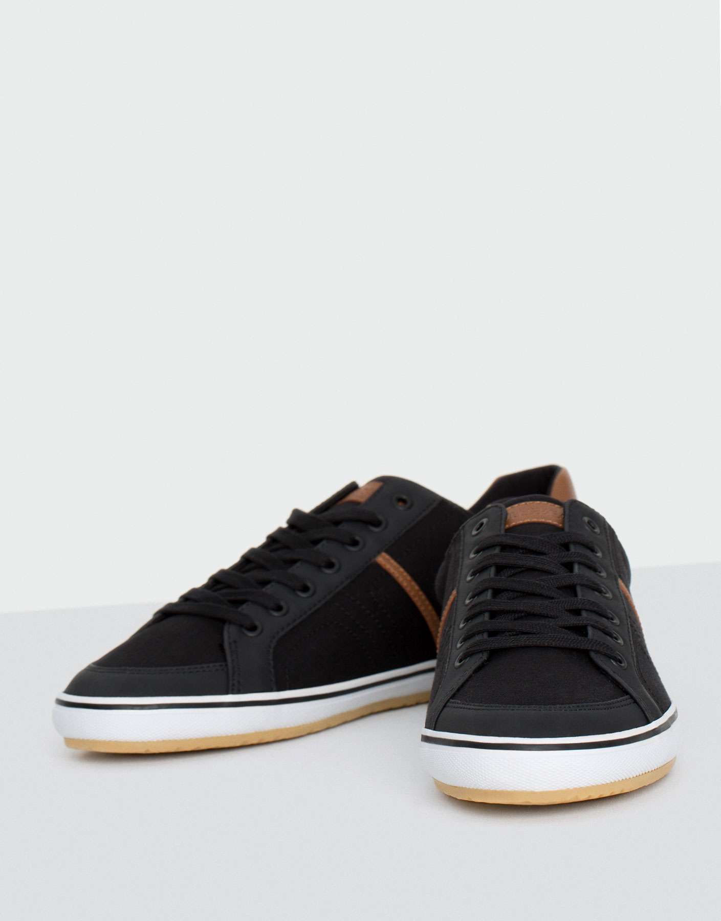Combined black canvas plimsolls