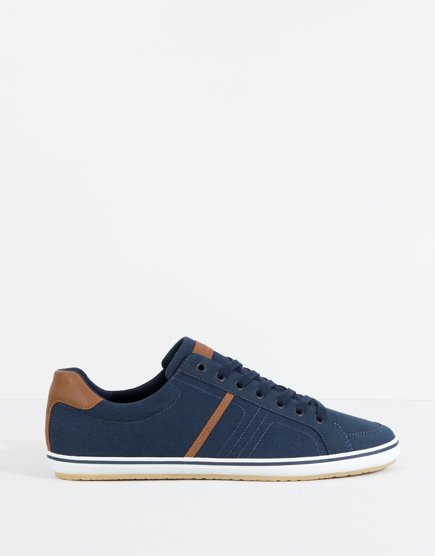 Combined blue canvas plimsolls
