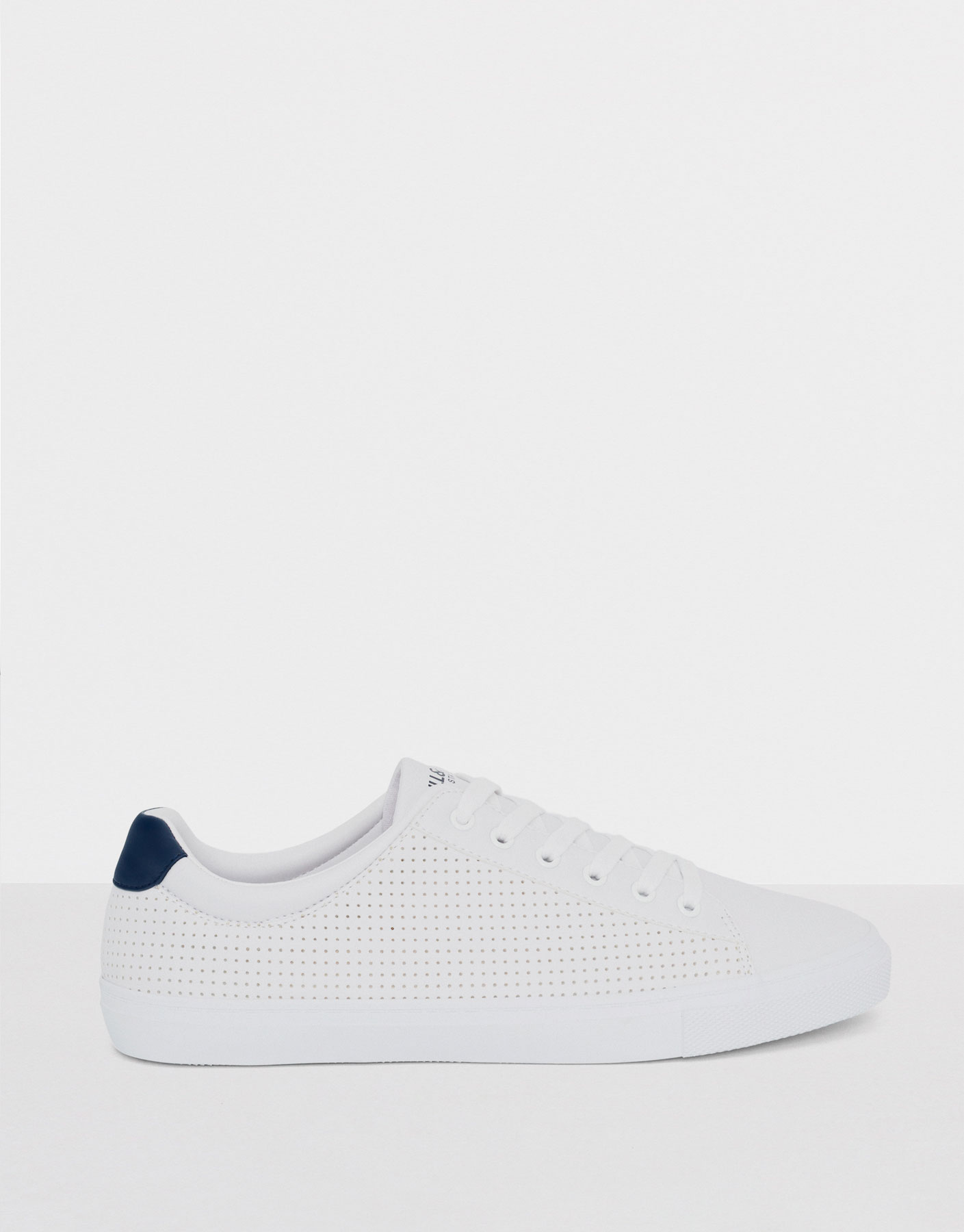 White plimsolls with punched detail
