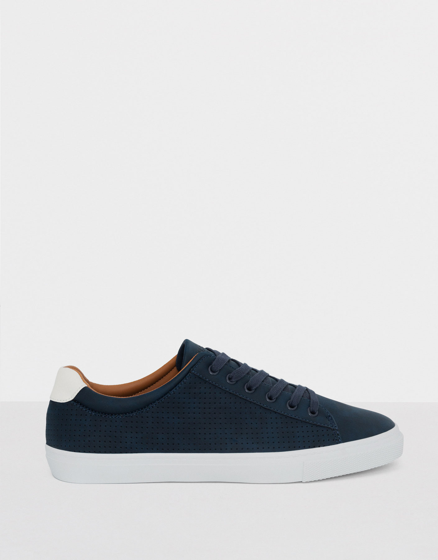 Blue plimsolls with punched detail