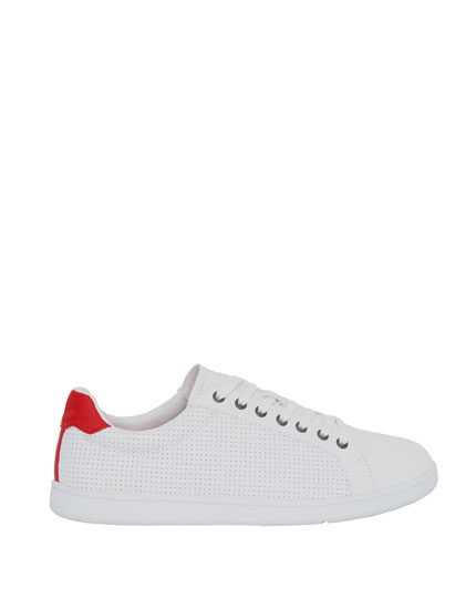 Punched detail plimsolls with red trim