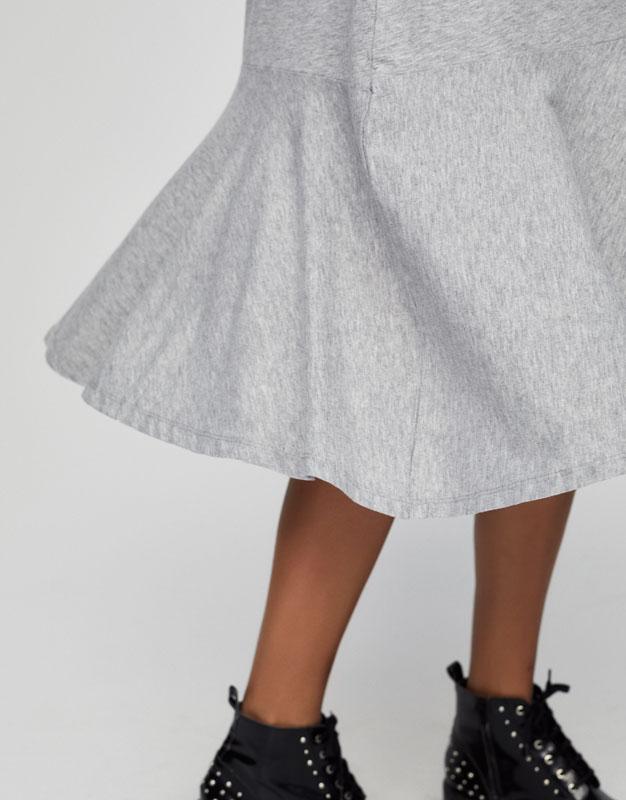 Long dress with ruffled hem