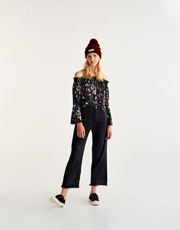 Kick flare jeans with frayed hem